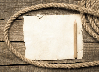Blank open notebook on sea rope on wooden table