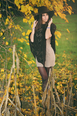 Young beautiful  woman posing in elegant autumn clothing