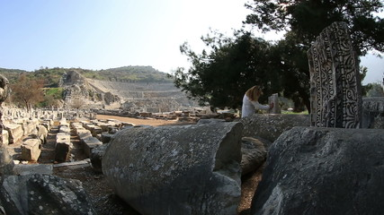 tourist visiting ruins ancient Ephesus Turkey, steadicam shoot