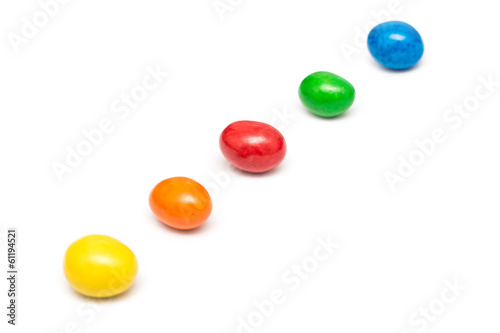 Colorful Row Of Coated Chocolate Candy Close Up Isolated