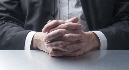 focus on hands of businessman being interviewed