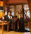 Elegant couple in formal dress in luxury cabinet interior
