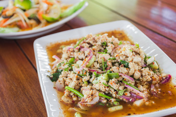 spicy minced pork salad with roasted rice powder