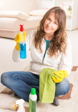 Beautiful young woman cleaning her house