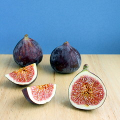 Fresh Figs sliced open on a chopping board