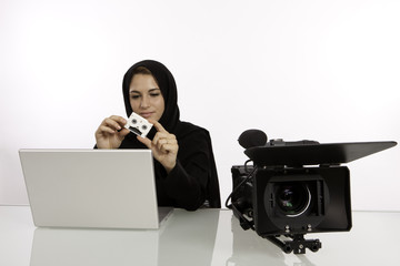 Arab Student Editor Holding Her Final Cut In A Studio