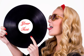 Isolated retro girl touching vinyl LP with tongue