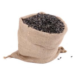 Close up of black sunflower seeds in bag.