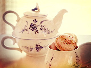 Macaroons in sugar bowl and vintage teapot
