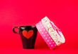 cup near gift on red background, concept of valentine day