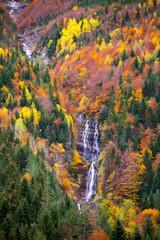 Autumn Bujaruelo Ordesa waterfal in colorful fall forest Huesca