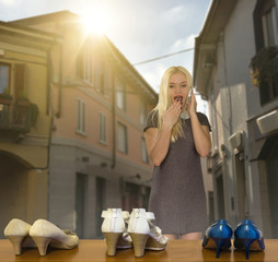 girl looks into a shop window to buy new shoes