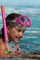 little girl with a mask for diving