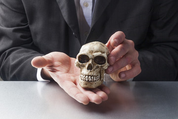 symbol of pychotherapy with skull in hands of professionals