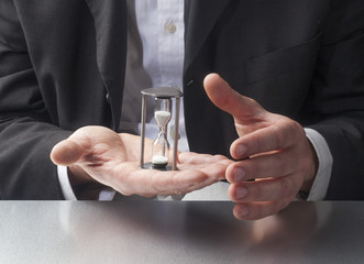 business man hands with hourglass in palm