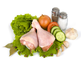 Raw chicken legs with salad isolated on white