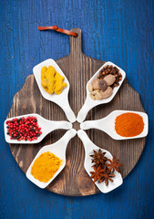 Various spices on a vintage board