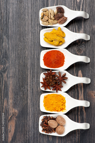 Various colorful spices on a vintage board