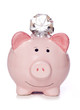 Wealthy saving piggy bank with diamonds
