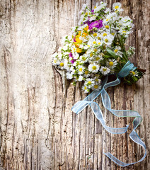 Rustic nastalgia background with field flowers