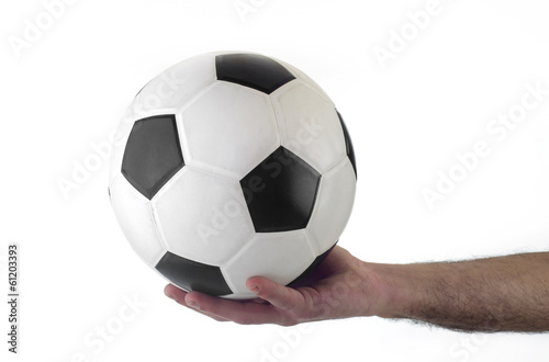 Hand holding soccer ball up isolated on white