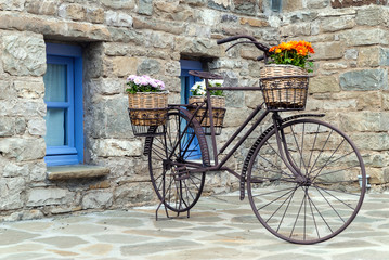 Rusty bicycle in front of a traditional house in Epirus, Greece
