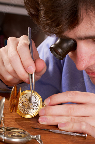 Watchmaker Repairing a Pocket Watch - 61203501