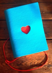 notebook with heart on wood