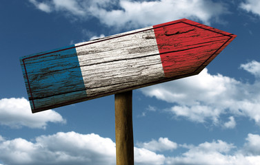 Wooden French sign on a wonderful day