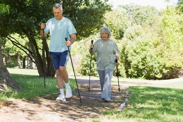 Mature couple Nordic walking at park