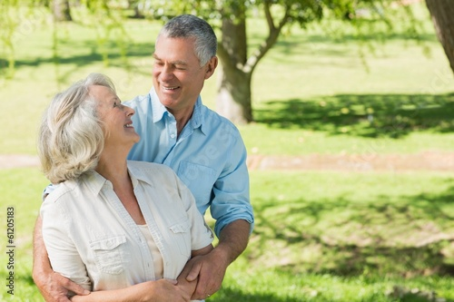 Loving and happy mature couple at park