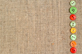 Burlap background with buttons border