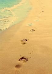 footprints on beach - vintage retro style