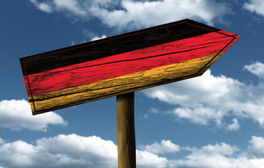 German flag wooden sign with a beautiful sky on background