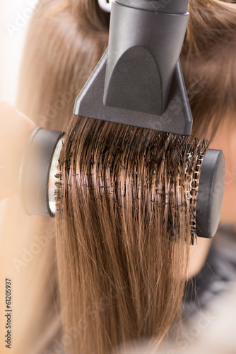 Drying long brown hair with hair dryer