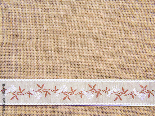 Burlap background with ribbon