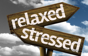 Relaxed x Stressed creative sign with clouds as the background