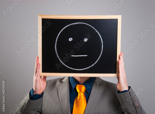 Businessman hiding his face with a white billboard with a neutra