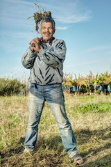 Senior farmer Holding a fork in the fields