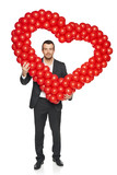 Businessman holding heart shape