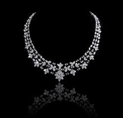 Diamond necklace shot against a black background