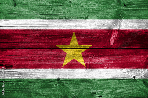 Suriname Flag painted on old wood plank texture