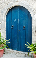 Old blue wooden door on Crete