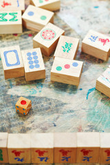 playing in mahjong game by wooden tiles