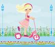 Leinwanddruck Bild - Little blonde girl riding a scooter