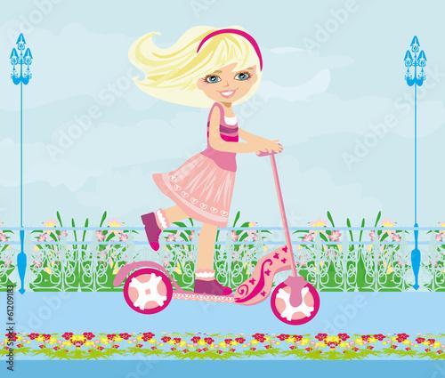 Leinwanddruck Bild Little blonde girl riding a scooter