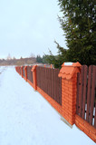 fence with wooden railings and brick pillars