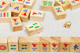 wooden tiles in mahjong game on textile table
