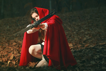 Little red riding hood aiming with crossbow