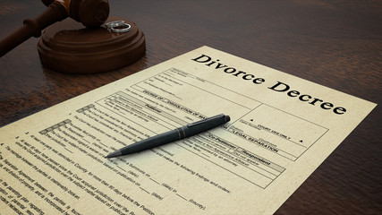 divorce decree paper with a pen, gavel and rings in the scene